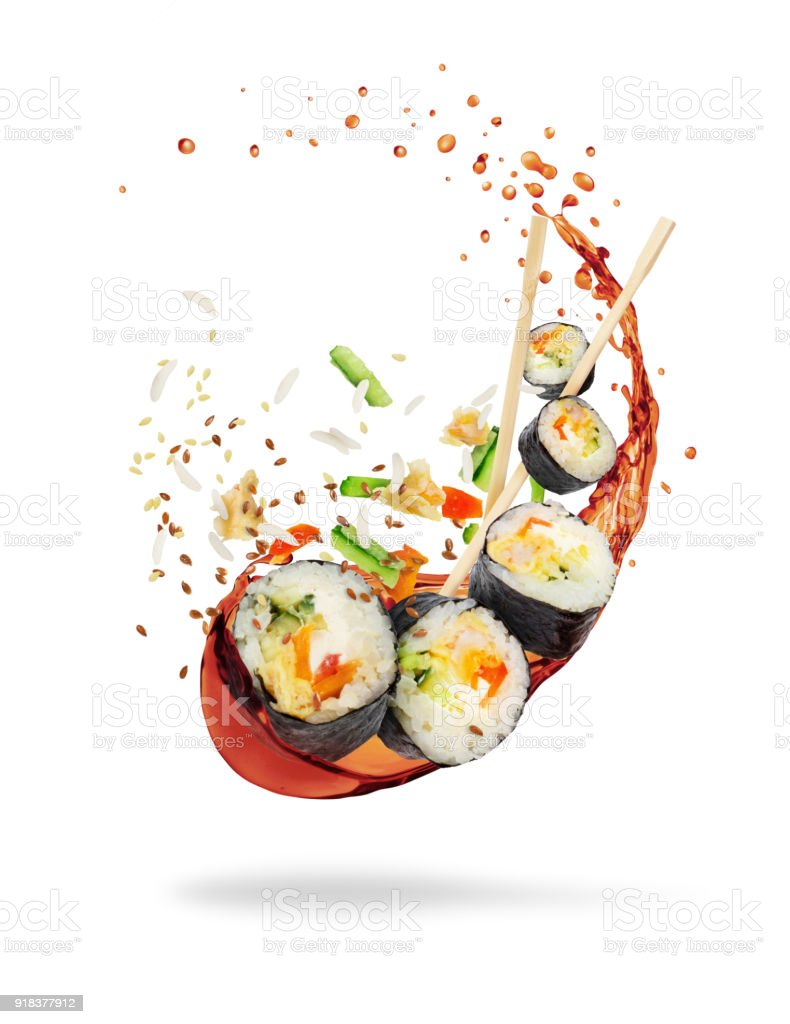 Pieces of sushi with splashes of soy sauce, isolated on white background stock photo