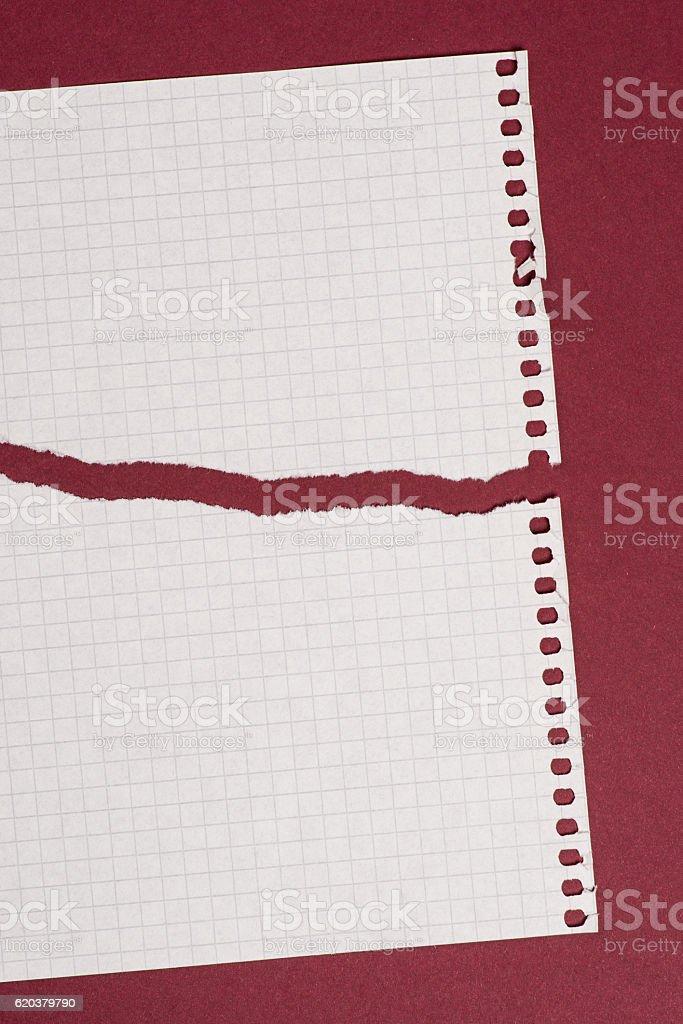 Pieces of torn paper over the dark red background zbiór zdjęć royalty-free