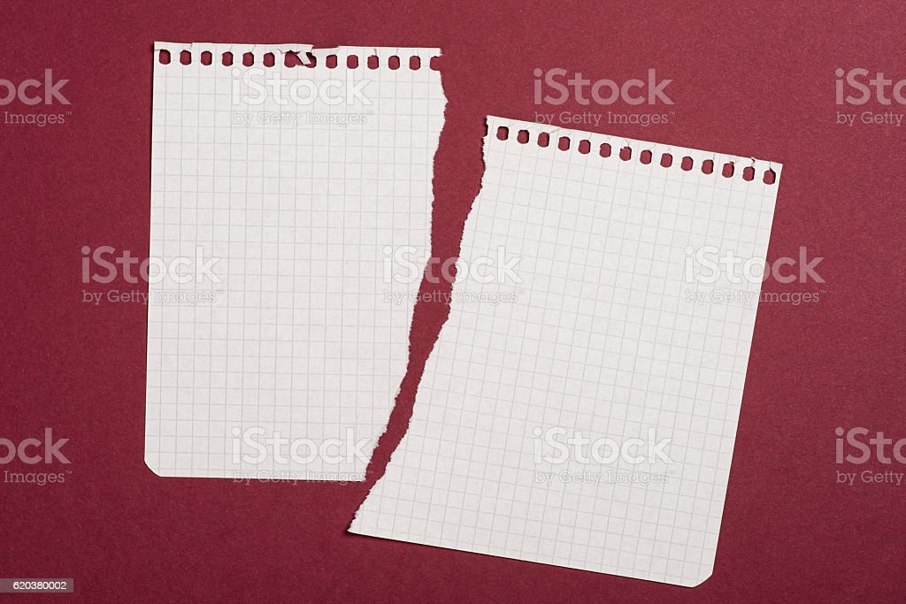 Pieces of torn paper over the dark red background foto de stock royalty-free