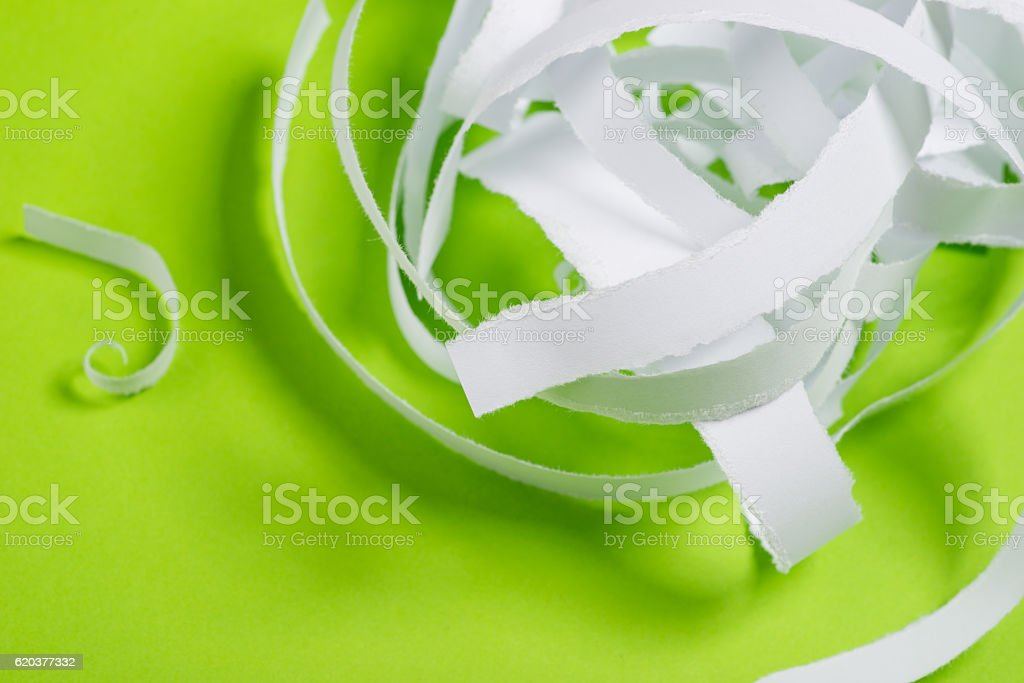 Pieces of torn paper over the green background zbiór zdjęć royalty-free