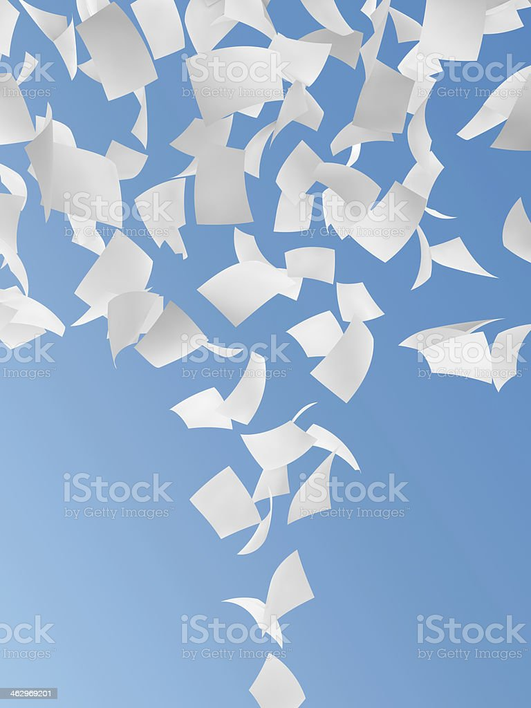Pieces of white paper falling from the sky stock photo