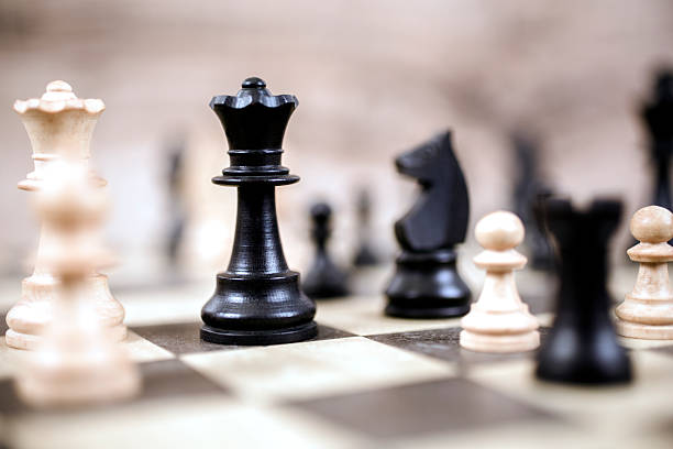 Pieces on chess game board.  King, horse.  Strategy concept. stock photo