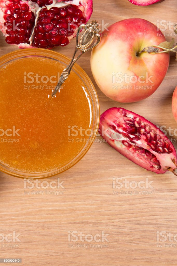Pieces ripe pomegranate, honey and apple stock photo