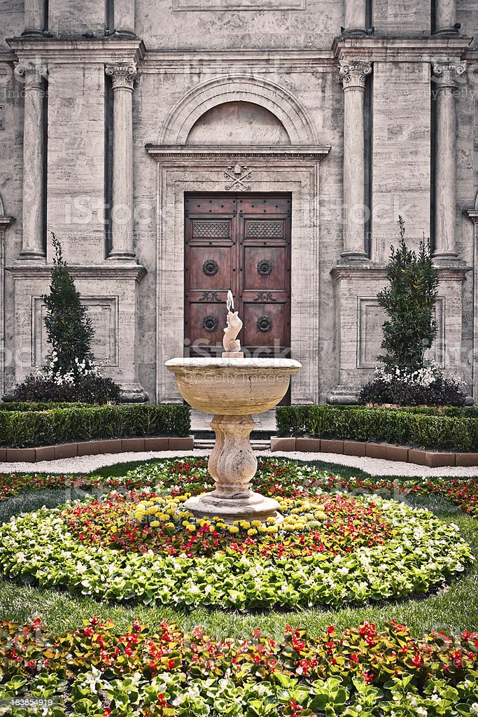 Pienza Cathedral with Colored Flowers, Architecture in Italy royalty-free stock photo