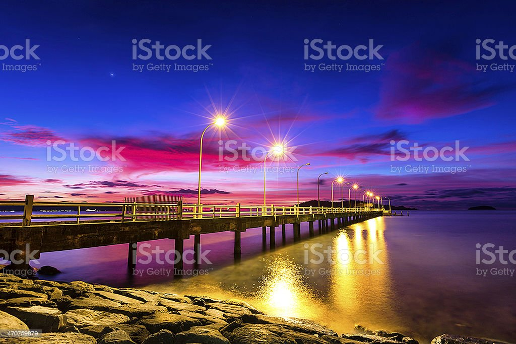 Pier after sunset stock photo