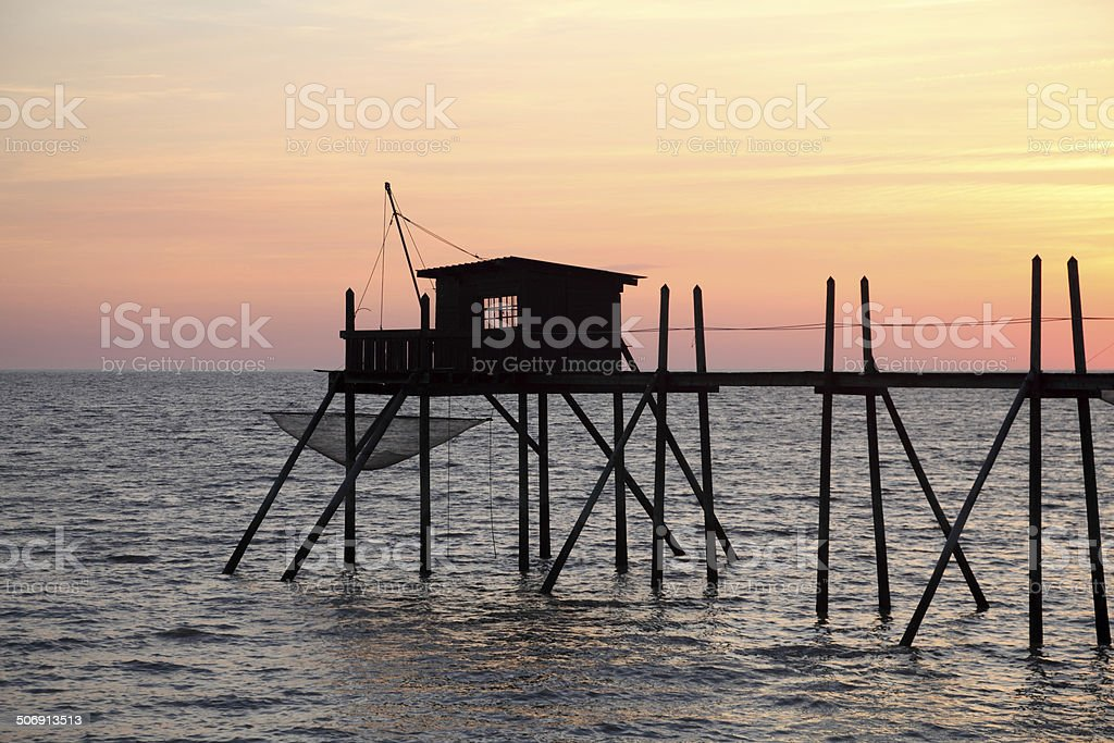 Pier and cabin for fishing at atlantic ocean stock photo