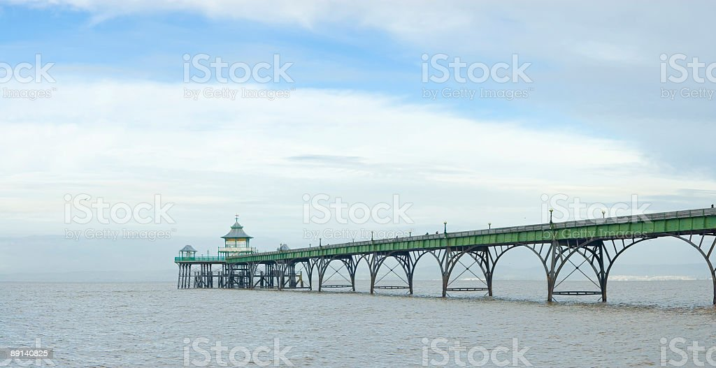 Pier and fishermen royalty-free stock photo