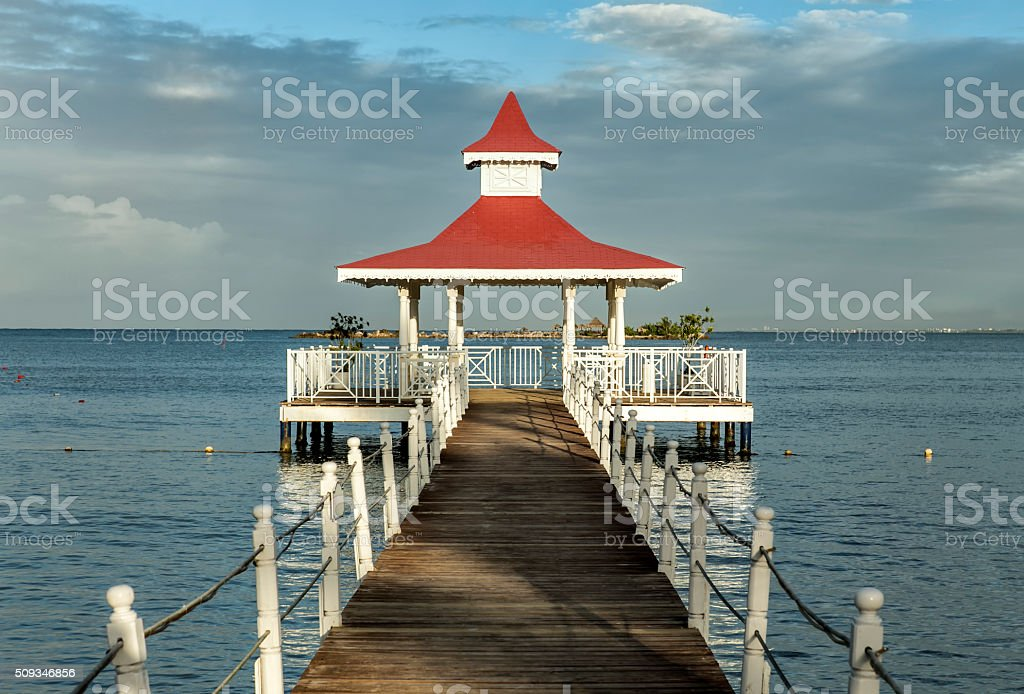 Pier and gazebo at Caribbean sea stock photo