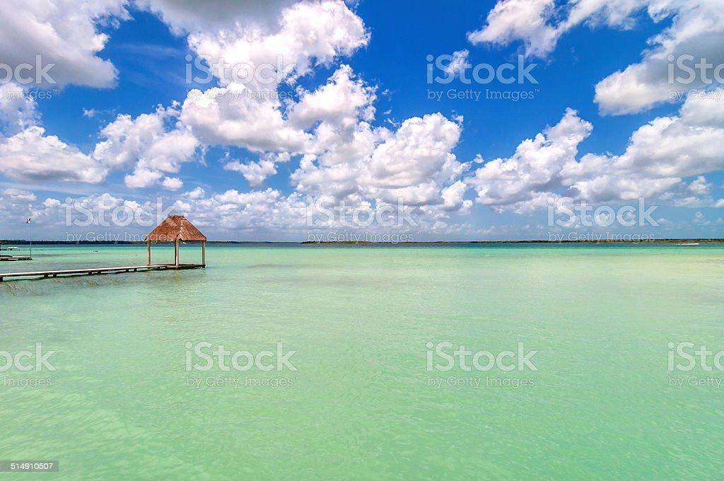 pier and palapa in Caribbean Bacalar lagoon, Quintana Roo, Mexico stock photo