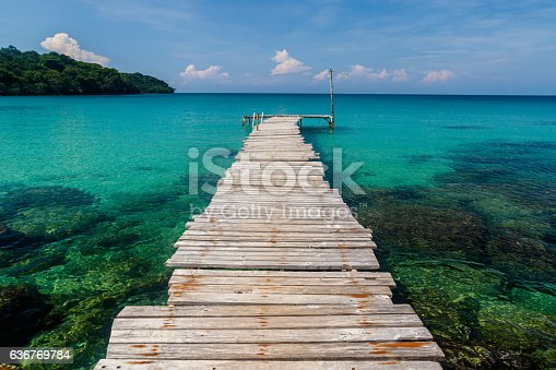 The pier at A-Na-Lay resort leads directly into the pristine waters of the bay at Sai Daeng beach, on the island of Koh Kood, Thailand.