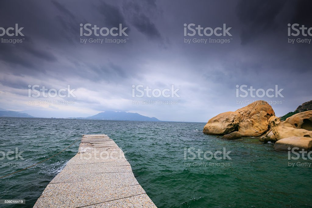 Pier at beach royalty-free stock photo