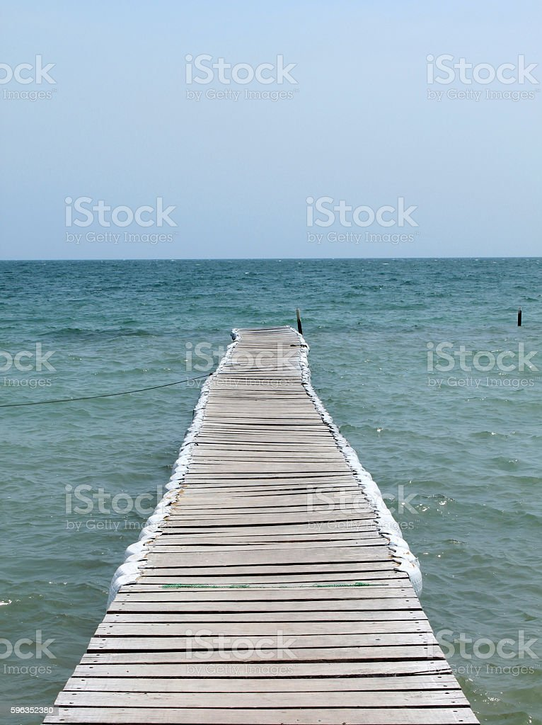 Pier at beach royalty-free stock photo