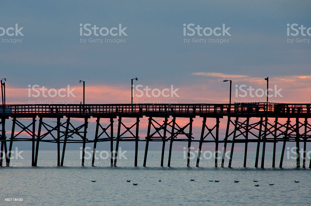 Pier at Dusk on Long Beach stock photo