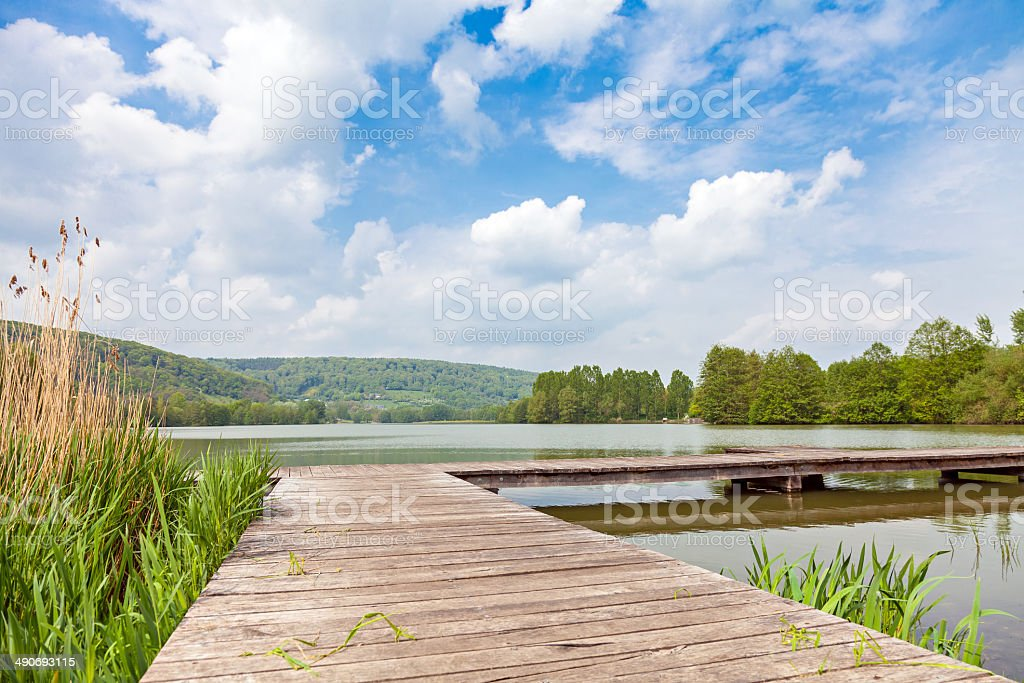 Pier at Lake Echternach in Luxembourg stock photo