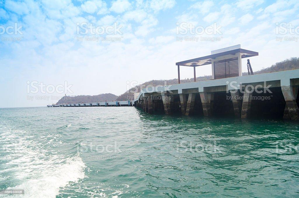 Pier at Santa Crz Huatulco Mexico stock photo