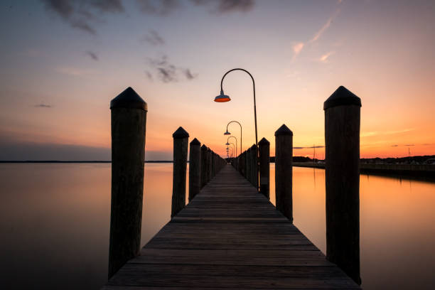 Pier at Sunset in a bay stock photo