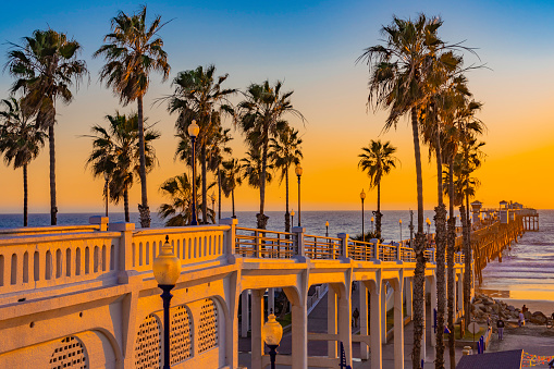 Oceanside is a coastal city in California. It's known for palm-dotted Harbor Beach and nearby Oceanside Harbor, with its marina and shops. To the south, the long Oceanside Pier juts into the Pacific Ocean