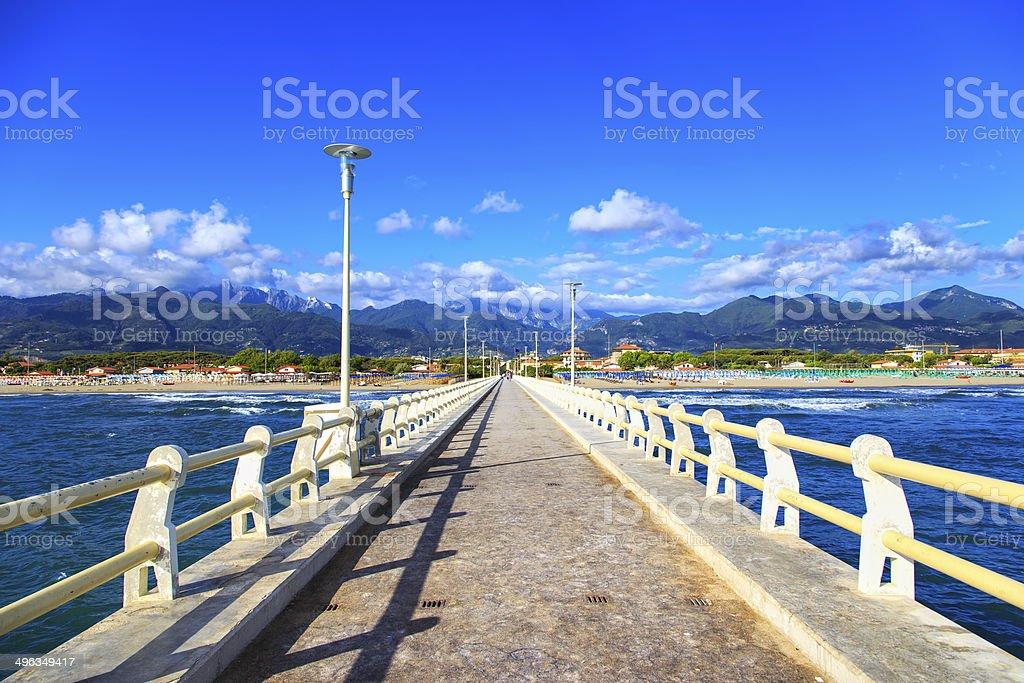 Pier, beach and Apuane mountains in Forte dei Marmi Versilia stock photo