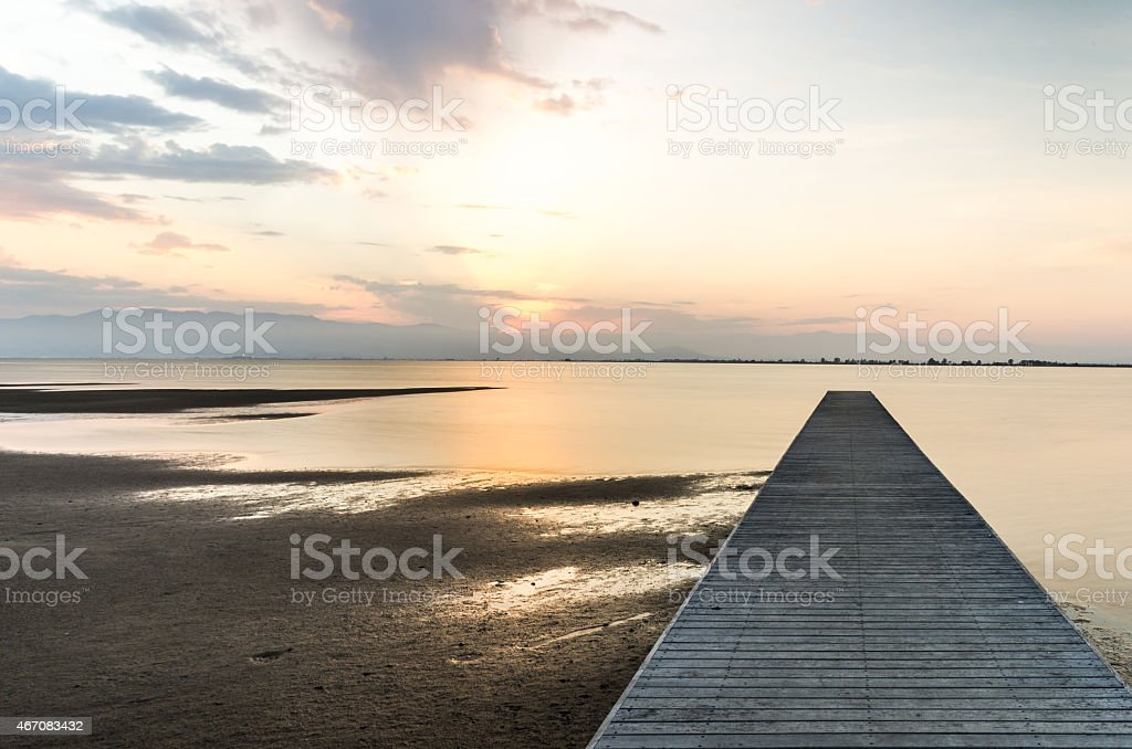 pier beach dusk right position sunset sunrise ebro stock photo