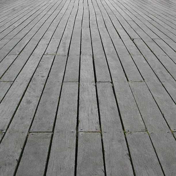 Pier Floor Perspective (Square) Shot along the wooden floor of a seaside pier. skeable stock pictures, royalty-free photos & images