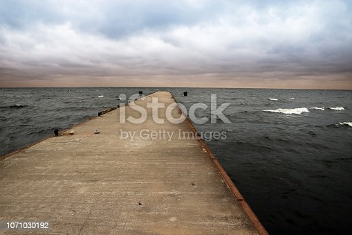 872969580istockphoto Pier going out into the Bay Cape Flotski under stormy skies. 1071030192