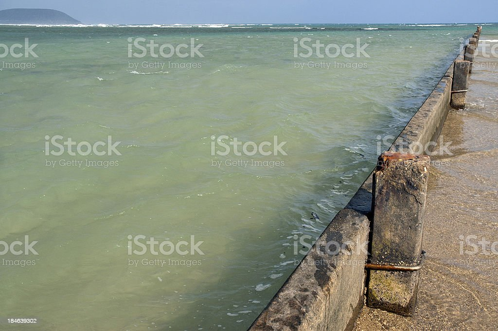 Pier Holding Back the Ocean stock photo