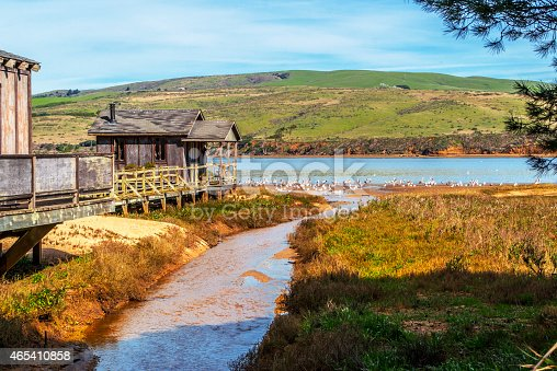 Old, wooden pier house on Tomales Bay in town of Inverness in Northern California