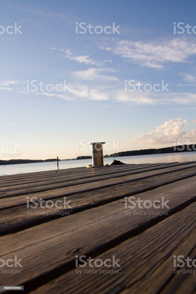 Pier in a finnish lake. Skyline in a summer day. стоковое фото