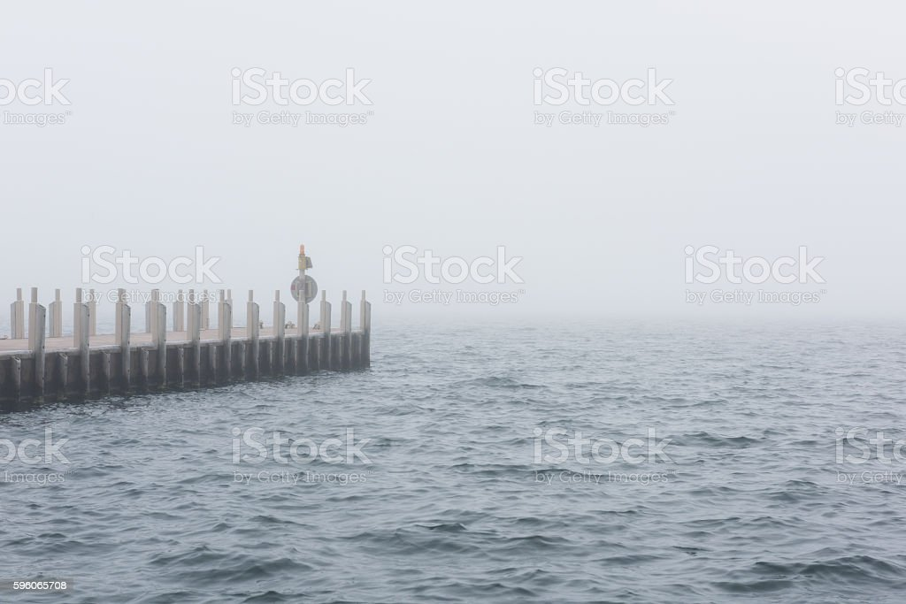 Pier in Misty Lake royalty-free stock photo