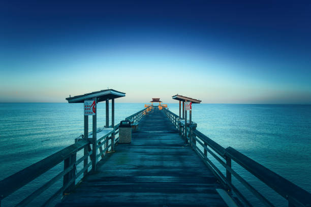 Pier in Naples, Florida Early bird picture of the end of the Naples Pier in Florida naples florida stock pictures, royalty-free photos & images