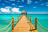 Wooden pier in the Dominican Republic into the ocean.