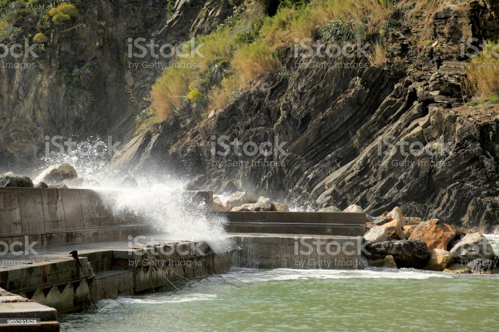 Pier in Vernazza during rough sea royalty-free stock photo