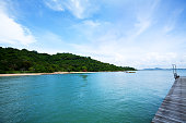 Pier into Gulf of Thailand in Rayong and view along coastline and beach. Area near Rayong Resort.