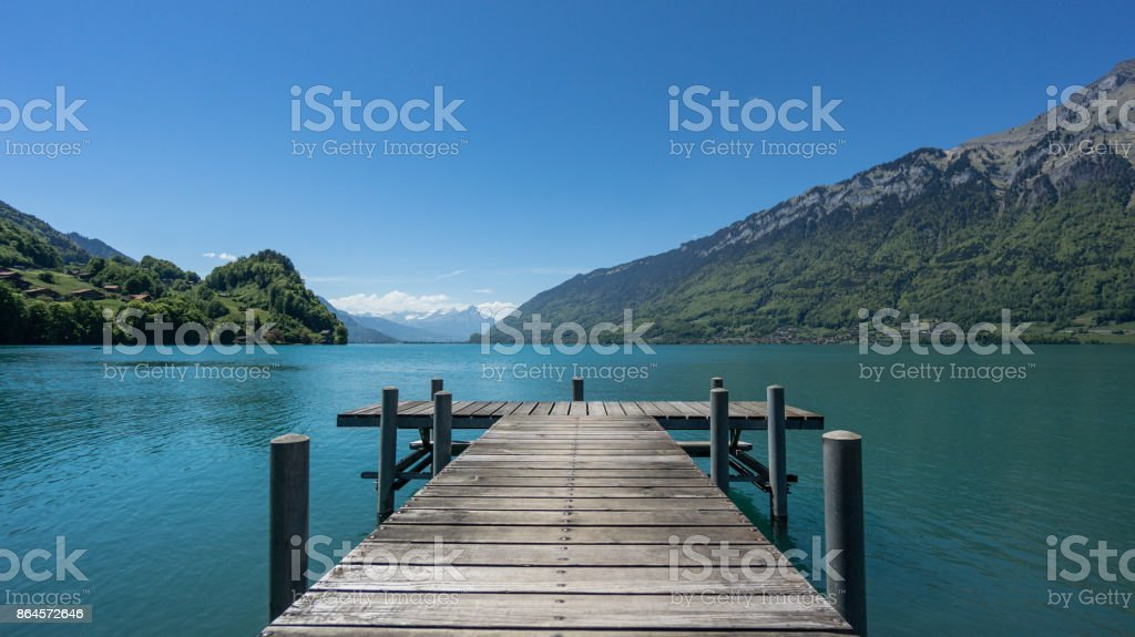 Pier into the lake Brienzersee in Iseltwald Switzerland stock photo
