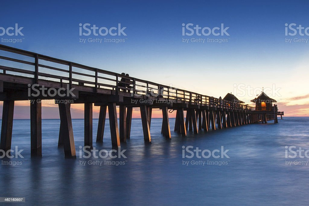 Pier of Naples at sunset stock photo