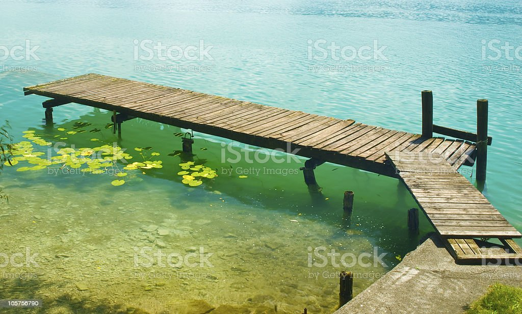 Pier on a clear Lake royalty-free stock photo