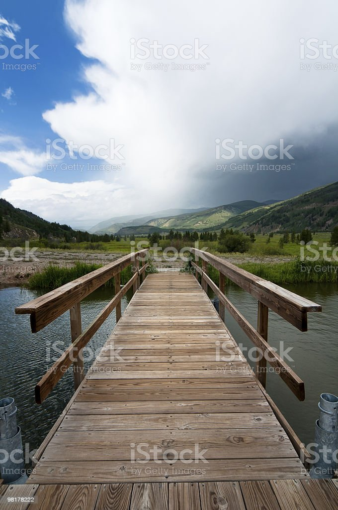 Pier on a mountain lake royalty-free stock photo