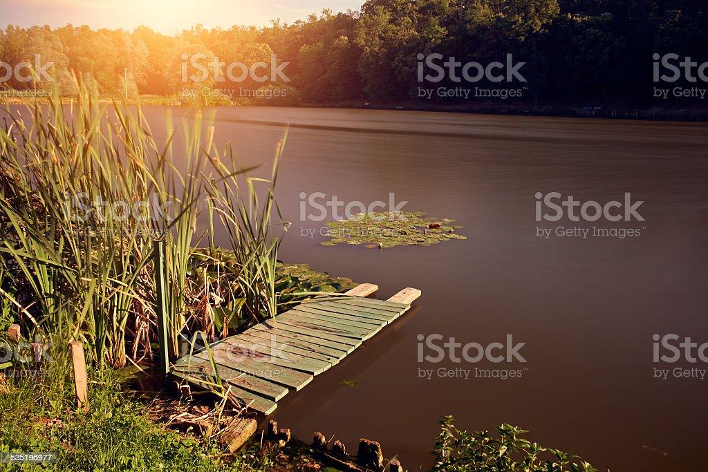 Pier on beautiful lake stock photo