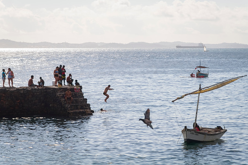 Salvador, Bahia, Brazil - August 25, 2018: Forte da Barra Pier. A historic landmark that attracts city dwellers and tourists to see the landscape better and jump into the sea.