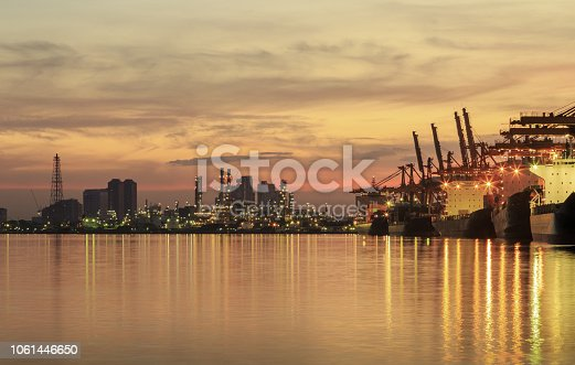 Port cargo shipping industry with morning sunrise in Bangkok, Thailand.