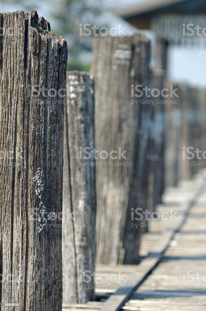 pier posts on ubein bridge, myanmar royalty-free stock photo