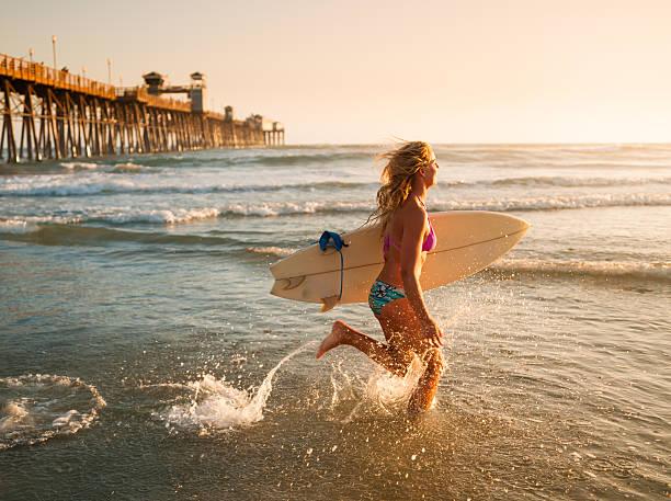 Pier Surfer stock photo