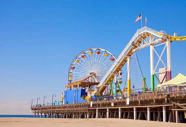 A pier that is located in Santa Monica, California  Santa Monica pier and beach boardwalk stock pictures, royalty-free photos & images
