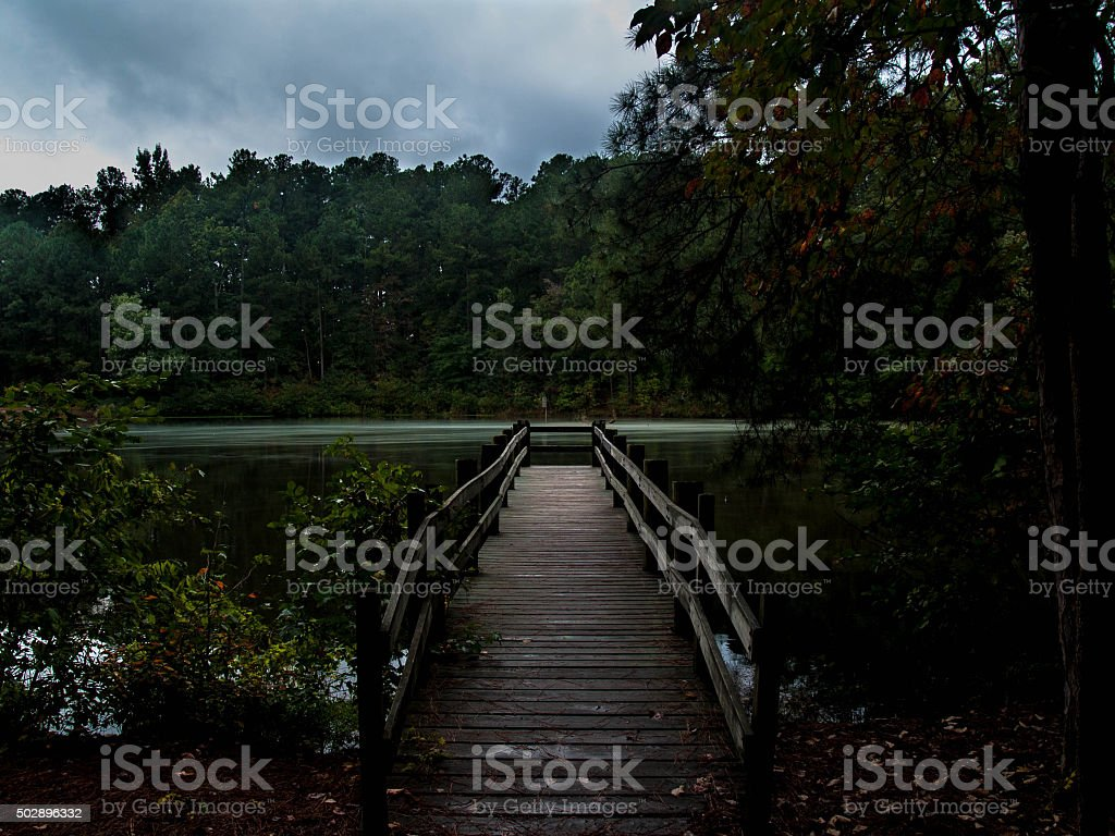 Pier to a Storm Covered Lake stock photo