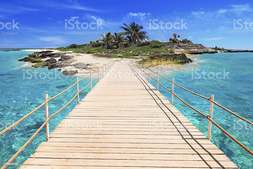 Pier to the tropical island of Caribbean Sea stock photo