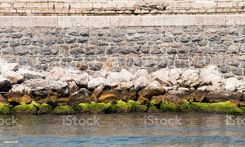 Pier Wall and Mossy Rocks royalty-free stock photo