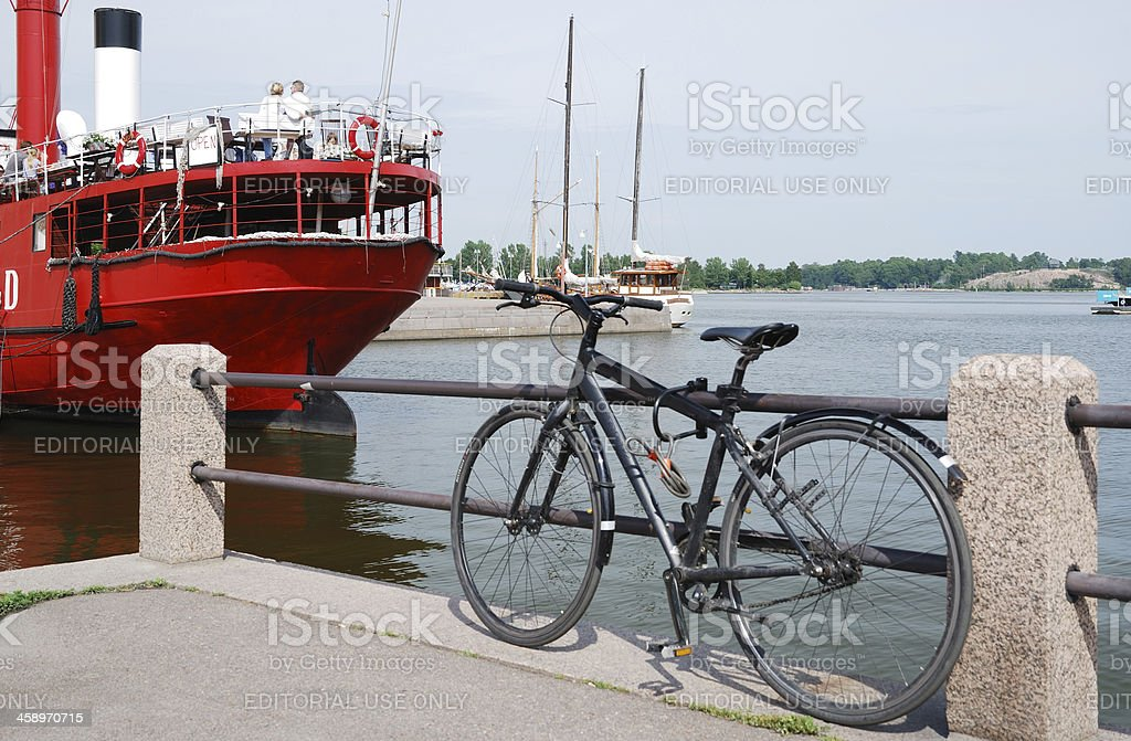 Pier with a bike and red steamship in Helsinki stock photo
