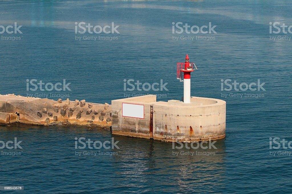 Pier with red beacon photo libre de droits
