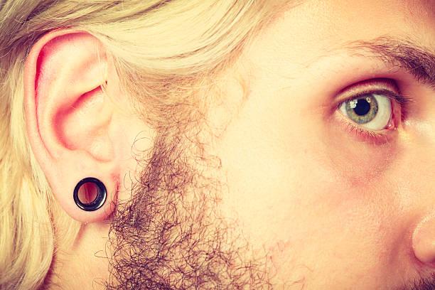 pierced man ear, black plug tunnel - gedehnte ohren stock-fotos und bilder