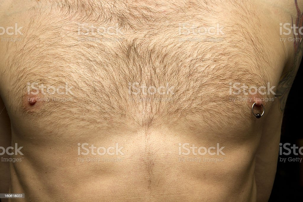Pierced Nipple On Man's Chest stock photo